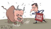 Карикатура - президент Турции Реджеп Тайип Эрдоган в виде быка, который готов броситься на президента Франции Эмманюэля Макрона в виде тореро с журналом Charlie Hebdo вместо красного платка в руках.
