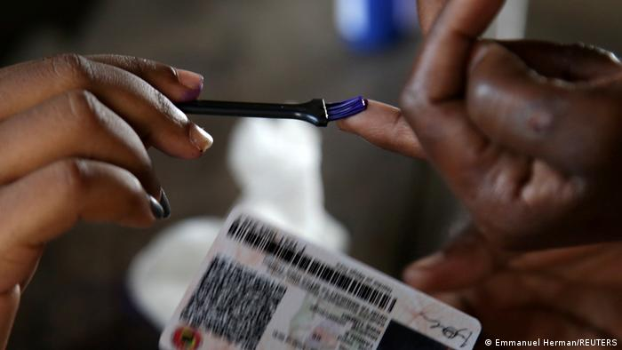 A Tanzanian voter has his finger marked with ink after casting his ballot during the presidential and parliamentary elections