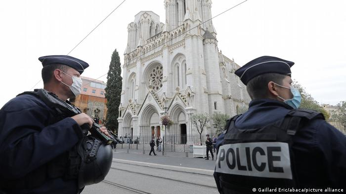 Police officers stand guard at the scene of a reported knife attack at Notre Dame church in Nice
