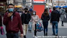 People wear protective face masks on the streets of Leipzig