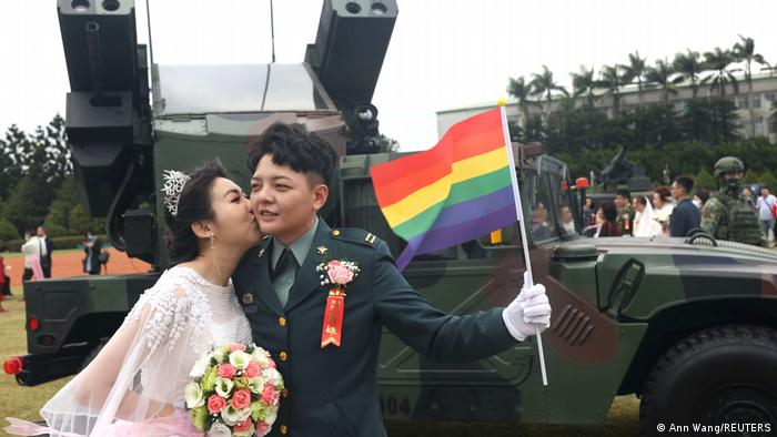 Chen Ying-Hsuan, a combat engineer lieutenant, and her wife, Li Chen-Chen