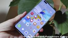The new Huawei Mate 40 Pro smartphone is held for a photo, in London, Wednesday Oct. 21, 2020. Huawei, has unveiled its Mate 40 line of phones, Thursday Oct. 22, 2020, a product release that comes at a crucial moment for the company. (AP Photo/James Brooks) |