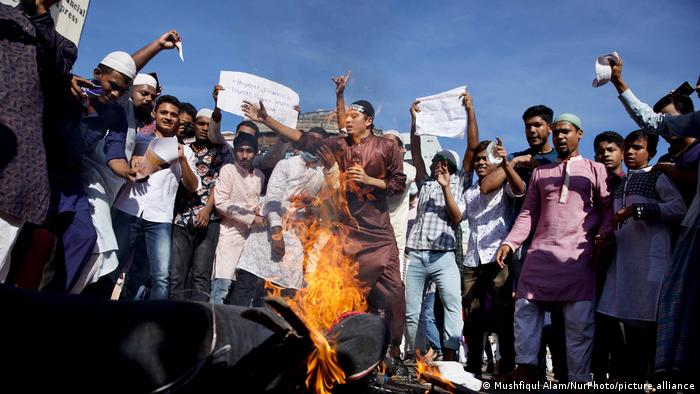 Protesters in Dhaka burned an effigy of French President Emmanuel Macron