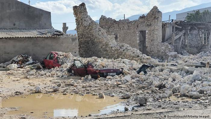 A destroyed car and collapsed buildings after an earthquake in the island of Samos (Eurokinissi/AFP/Getty Images)