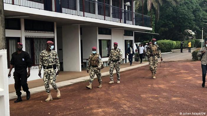 Security personnel in front of a polling booth in Ivory Coast