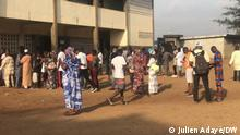 People line up in front of polling stations in Ivory Coast