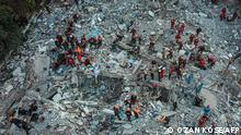 An aerial view showing rescue workers in Izmir searching for survivors