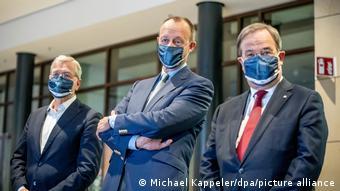 Кандидаты на пост председателя ХДС Рёттген, Мерц и Лашет в масках