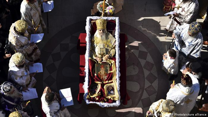 Thousands gathered by an open casket with Bishop Amfilohije's body during the liturgy