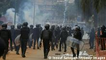 TOPSHOT - Ivorian anti-riot police use tear gas to disperses opposition supporters in Blockhauss, Abidjan, on October 31, 2020, during Ivory Coast's presidential election. (Photo by Issouf SANOGO / AFP) (Photo by ISSOUF SANOGO/AFP via Getty Images)