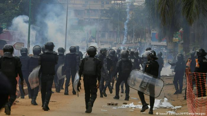 Anti-riot police use tear gas to disperses opposition supporters