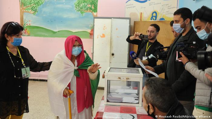 Algerians caste their ballots in a constitutional referendum at a school in Algiers