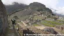 A maintenance worker carries a bag of stones at the Machu Picchu archeological site that's closed to the public amid the COVID-19 pandemic in the department of Cusco, Peru, Tuesday, Oct. 27, 2020. The world-renown Incan citadel of Machu Picchu will reopen to the public on Nov. 1. (AP Photo/Martin Mejia) |