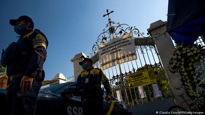 Police outside a Mexico City cemetery