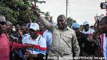 Tanzania Chadema party chairman Freeman Mbowe (C) arrives at the party's headquarters after being released from Segerea prison in Dar es Salaam, Tanzania, on March 13, 2020. - Chadema party, the main opposition movement challenging Tanzania's powerful ruling CCM party, paid his fine of 70 million Tanzanian Shillings (about 30,400 USD) which collected by online fund-raising. A court in Tanzania on March 10, 2020, ordered a group of opposition lawmakers and other co-accused to pay a fine or serve five months prison on charges related to a banned demonstration. (Photo by Ericky BONIPHACE / AFP) (Photo by ERICKY BONIPHACE/AFP via Getty Images)