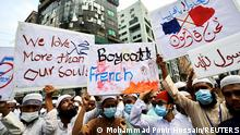Supporters and activists of the Hefazat-e-Islam Bangladesh, an islamist political party, holds placards as they take part in a protest calling for the boycott of French products and denouncing French president Emmanuel Macron for his comments over Prophet Mohammed's caricatures, in Dhaka, Bangladesh, November 2, 2020. REUTERS/Mohammad Ponir Hossain
