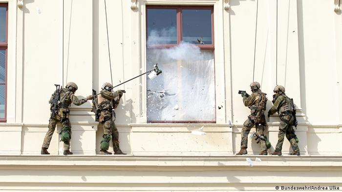 KSK soldiers breaking into a building