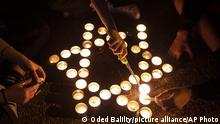 Israelis light memorial candles on the 25th anniversary of the assassination of Israeli Prime Minister Yitzhak Rabin, at Rabin Square, Tel Aviv, Israel, Thursday, Oct. 29, 2020. (AP Photo/Oded Balilty) |