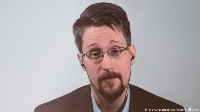 Edward Snowden on a video screen