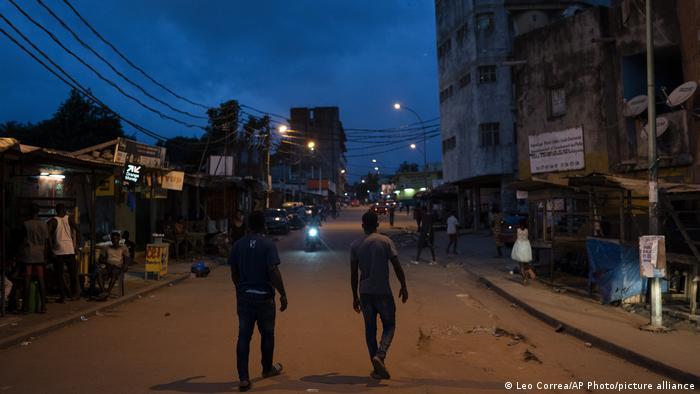 Men walk on a street in Abidjan.