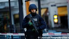 A police officer stands guard in fornt of a secured area after exchanges of gunfire in Vienna, Austria November 3, 2020. REUTERS/Leonhard Foeger