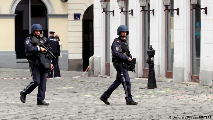 Armed police walk in central Vienna