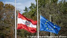 03.11.2020, Berlin: Die Österreichische und Europäische Flagge hängen vor der Österreichischen Botschaft in Berlin auf Halbmast. Foto: Fabian Sommer/dpa | Verwendung weltweit