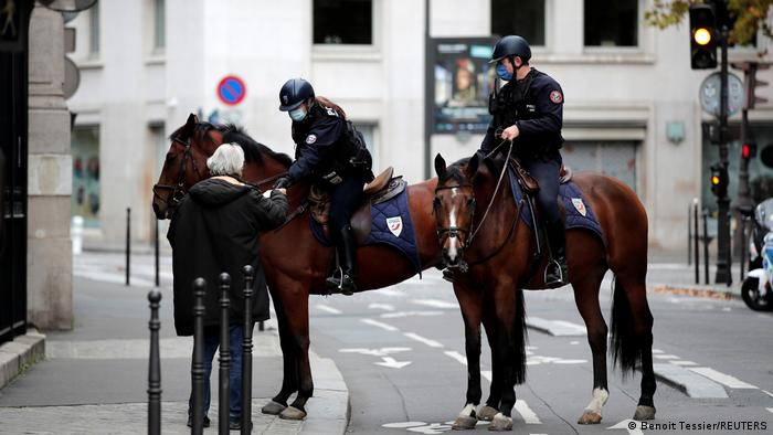 Police officers on horses conduct a control to check exemption certificates and verify identity on the Champs-Elysee avenue