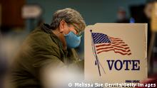 FAYETTEVILLE, NC - NOVEMBER 03: Barb Lambert fills out a ballot in the General Election with in the first half hour of voting on November 3, 2020 in Fayetteville, United States. After a record-breaking early voting turnout, Americans head to the polls on the last day to cast their vote for incumbent U.S. President Donald Trump or Democratic nominee Joe Biden in the 2020 presidential election. (Photo by Melissa Sue Gerrits/Getty Images)
