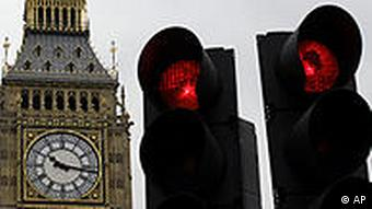 Red traffic lights in Parliament Square in front of the 'Big Ben' clock tower