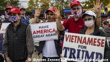 October 12, 2020, Columbus, Ohio, United States: Vietnamese Trump supporters wearing facemasks show their appreciation for Trump at the Pence rally venue..Vice President Mike Pence stops in Columbus, Ohio to hold a rally at a local company Savko & Sons Inc. while on the campaign trail. (Credit Image: © Stephen Zenner/SOPA Images via ZUMA Wire |