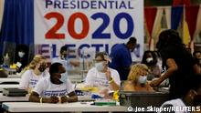Elections workers open ballots at the Palm Beach County Elections Office during the 2020 U.S. presidential election in West Palm Beach, Florida, U.S. November 3, 2020. REUTERS/Joe Skipper