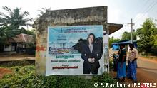 A banner featuring U.S. Democratic vice presidential nominee Kamala Harris is seen pasted on a wall at a bus stop at the village of Thulasendrapuram, where Harris' maternal grandfather was born and grew up, in the southern Indian state of Tamil Nadu, India, November 4, 2020. REUTERS/P. Ravikumar