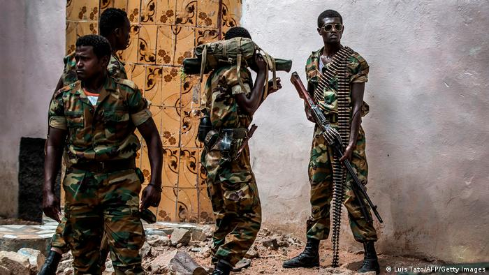 Armed Ethiopian soldiers stand on a street in Somalia