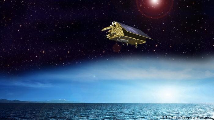 Illustration Sentinel-6 hovers above a the atmosphere. A blue ocean appears at the bottom of the picture. Just above the ocean is a noon day sun. A dark starry night is above the light blue noon sky. The Sentinel-6 floats among the stars.