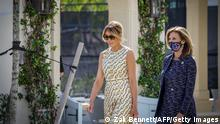 After voting, First Lady Melania Trump(L) leaves the Morton and Barbara Mandel Recreation Center with the Palm Beach County Supervisor of Elections Wendy Sartory Link in Palm Beach, Florida on November, 3, 2020. - The First Lady is registered to vote at her address at the Mar-a-Lago Club in Palm Beach, Florida. The center was closed for approximately 45 minutes to accommodate Mealnia Trumps vote. With its 29 electoral votes, Florida is crucial to both candidates. (Photo by Zak BENNETT / AFP) (Photo by ZAK BENNETT/AFP via Getty Images)