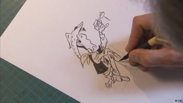 Achdé dibujando una figura de Lucky Luke