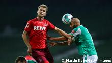 BREMEN, GERMANY - NOVEMBER 06: Sebastian Andersson of 1. FC Koln competes for a header with Omer Toprak of SV Werder Bremen during the Bundesliga match between SV Werder Bremen and 1. FC Koeln at Wohninvest Weserstadion on November 06, 2020 in Bremen, Germany. Sporting stadiums around Germany remain under strict restrictions due to the Coronavirus Pandemic as Government social distancing laws prohibit fans inside venues resulting in games being played behind closed doors. (Photo by Martin Rose/Getty Images)
