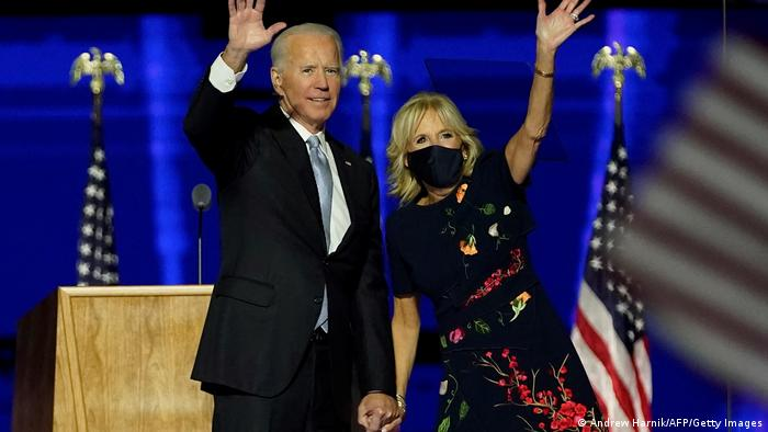 US President-elect Joe Biden and his wife Jill Biden wave from the stage