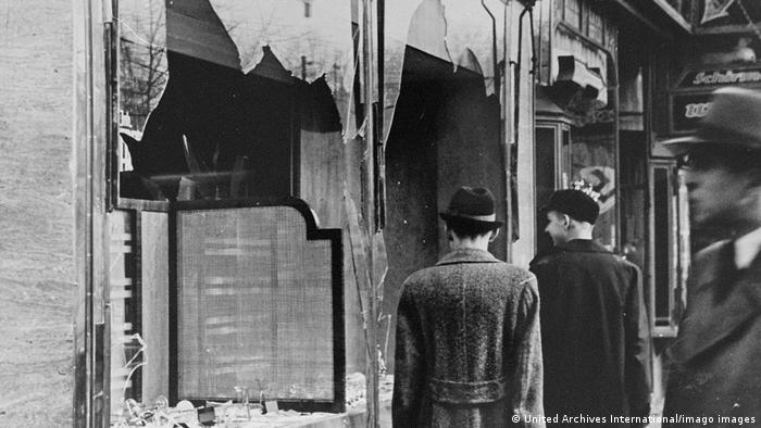 Archive image: Germans pass by the smashed windows of a Jewish-owned shop. The aftermath of Kristallnacht (Night of Broken Glass) 9-10 November 1938, the German anti-semitic pogrom , when over 200 Synagogues were destroyed and thousands of Jewish homes and businesses were ransacked.