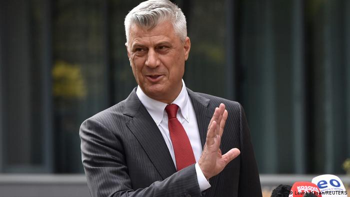 Hashim Thaci with raised right hand as he announces his resignation