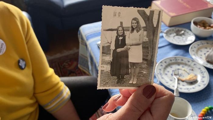 Ohnweiler holds a photo of herself and her grandmother