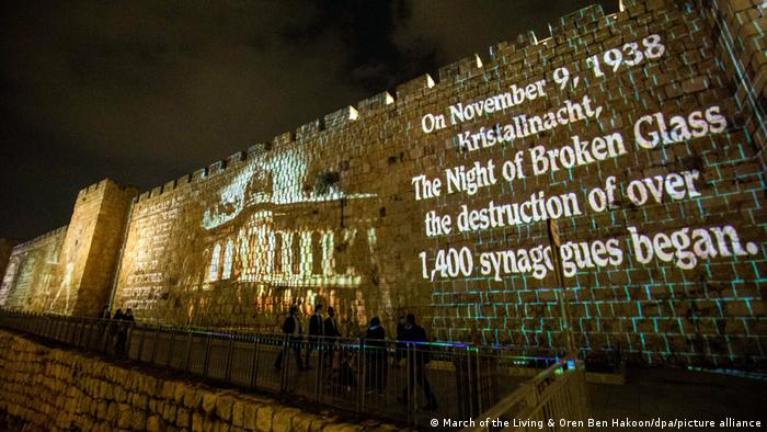Jerusalem's Old City walls, with a written message projected on them.