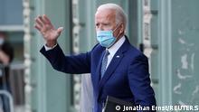 U.S. President-elect Joe Biden carries folders as he departs following briefings with members of his Transition COVID-19 Advisory Board in Wilmington, Delaware, U.S., November 9, 2020. REUTERS/Jonathan Ernst??