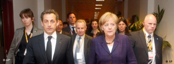 French President Nicolas Sarkozy, second left, walks with German Chancellor Angela Merkel, second right, after a meeting on the sidelines of an EU summit in Brussels, Friday, May 7, 2010. The 16 leaders of the euro zone meet Friday to finalize the Greek rescue plan and assess how such financial crises can be avoided in the future. (AP Photo/Michel Euler, Pool)