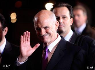 Greek Prime Minister George Papandreou leaves after an EU summit in Brussels, Saturday, May 8, 2010. The 16 leaders of the euro zone meet Friday to finalize the Greek rescue plan and assess how such financial crises can be avoided in the future. (AP Photo/Geert Vanden Wijngaert)