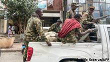08.11.2020 *** Members of the Amhara militia, that combat alongside federal and regional forces against northern region of Tigray, ride on the back of a pick up truck in the city of Gondar, on 08 November 2020. (Photo by EDUARDO SOTERAS / AFP)