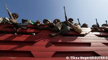 Members of Amhara region militias ride on their truck as they head to the mission to face the Tigray People's Liberation Front (TPLF), in Sanja, Amhara region near a border with Tigray, Ethiopia November 9, 2020. REUTERS/Tiksa Negeri