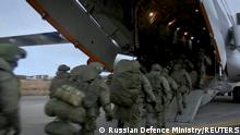 A still image from a video released by the Russian Defence Ministry shows Russian peacekeepers boarding a plane before departing for the region of Nagorno-Karabakh at an airdrome in Ulyanovsk, Russia November 10, 2020. Russian Defence Ministry/Handout via REUTERS TV ATTENTION EDITORS - THIS IMAGE HAS BEEN SUPPLIED BY A THIRD PARTY. NO RESALES. NO ARCHIVES. MANDATORY CREDIT.?