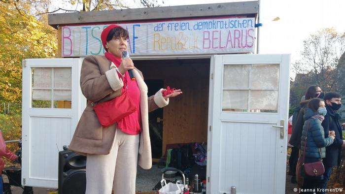 Woman speaking at alternative 'embassy' Belraus in Berlin